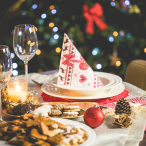 A table set with festive decorations for a holiday dinner.